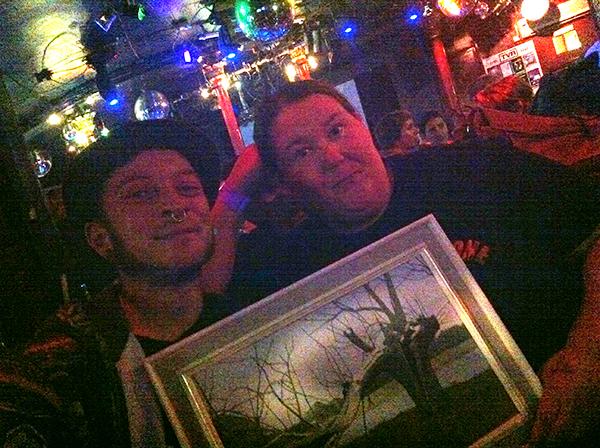 Al accepting his painting at the Royal Vauxhall Tavern